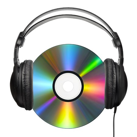 colorfully: A colorfully reflecting CD with professional headphones put on it