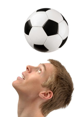 Isolated studio shot of a young soccer player playing the ball with his head Stock Photo - 7055053