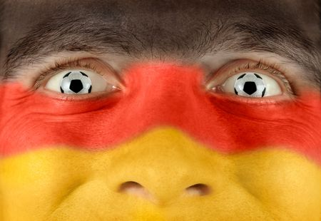 Closeup of a soccer fan with the German colors all over his face and balls as eyes Stock Photo - 7055075