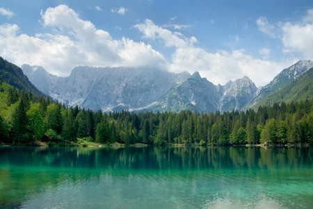 Beautiful landscape with turquoise lake, forest and mountains photo