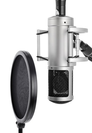 recordings: Vocal recording setup containing a professional microphone and pop filter on white background