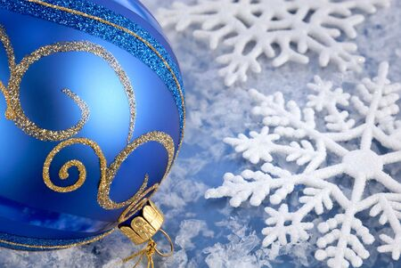Seasonal arrangement with blue-gold bauble and beautiful snowflakes photo