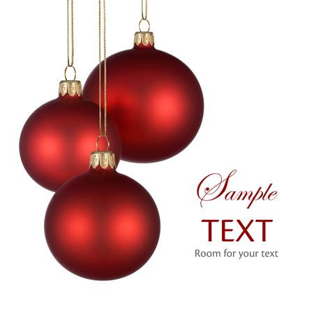 Christmas arrangement with three red baubles on pure white background for your text andor design photo