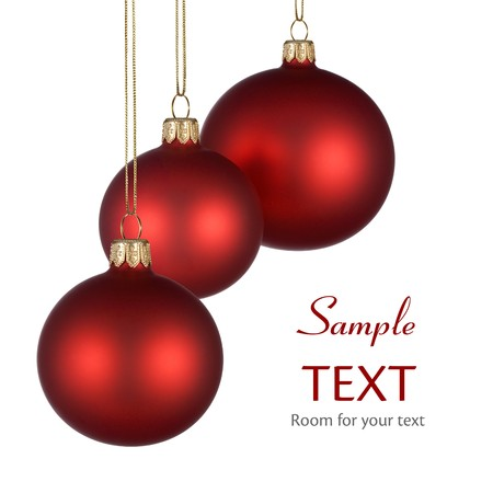 seasonal symbol: Christmas arrangement with three red baubles on pure white background for your text andor design