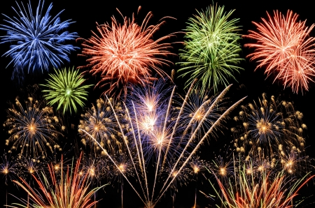 Spectacular multi-colored fireworks celebrating the New Year, the Independence Day or any other great event Stock Photo - 8332313