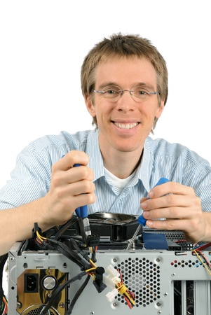 Studio shot of a young support technician with a trustworthy smile repairing a computer photo