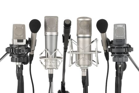 recording studio: Studio shot of seven professional microphones in a row on white background