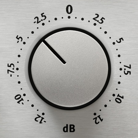 volume knob: Studio closeup of a metallic volume knob with numbers from -12 to 12 dB