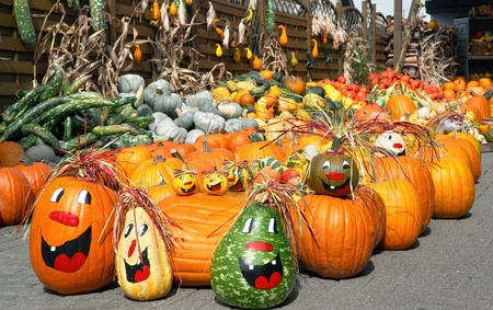 creatively: Cheerful looking heap of different pumpkins, creatively painted and arranged Stock Photo