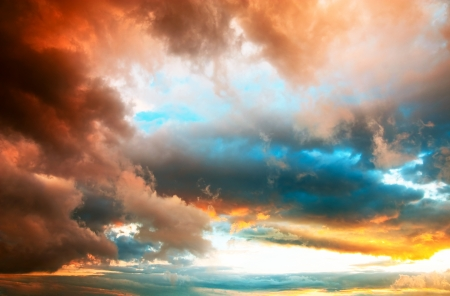 Amazing dramatic sunset cloudscape with vivid colors and depth photo
