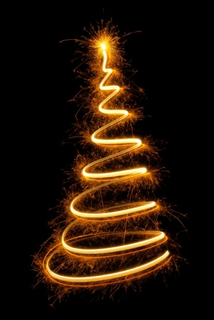 twinkling: Sparkling spiral as a magical Christmas tree with glowing top on black background