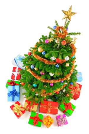 Top view isolated studio shot of a very colorful Christmas tree with gifts  photo