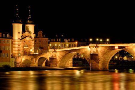 Heidelberg, Germany, night shot of the illuminated historical Old Bridge photo