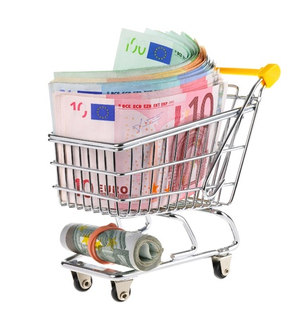 euro banknotes: Conceptual studio shot of a bunch of euro banknotes filling a shopping cart on white background Stock Photo