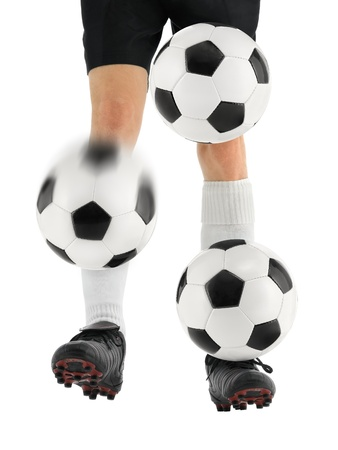 Skilled soccer player shows awesome juggling of three balls on his feet Stock Photo - 13535609