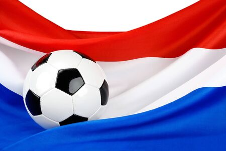 dutch: Soccer ball on a nicely hanging Dutch flag as a symbol for Hollands passion for football