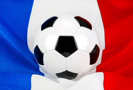 Soccer ball on a French flag hanging in a spiffy way as a symbol for France's love of football Stock Photo - 13724635