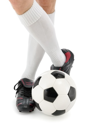 Football player's feet with the ball in a casual pose, isolated studio shot Stock Photo - 13726599