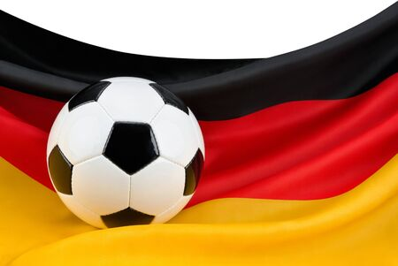 Soccer ball on a nicely hanging German flag as a symbol for Germany photo