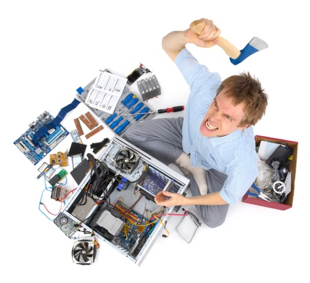 decides: Stressed man with ferocious expression decides to solve his computer problems with an axe