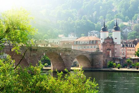 places of interest: Heidelberg, Germany, the historical  Old Bridge  and Neckar river in the morning sunlight