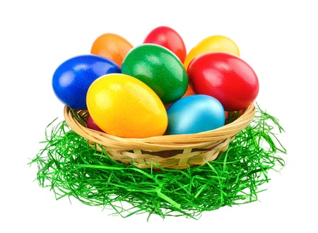 Basket with Easter eggs, bright vibrant primary colors, isolated on white background  photo