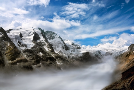 majestic mountain: Majestic mountain range in the European Alps on a beautiful day, with fog in the valley