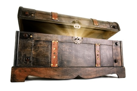 secret: Vintage treasure chest opens to reveal a luminous but hidden secret Stock Photo