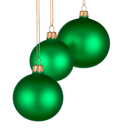 Christmas arrangement with three green baubles on pure white space for your text or design photo