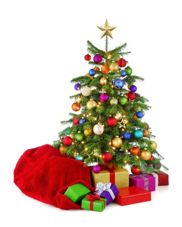 Bright and colorful studio isolation of a very colorful Christmas tree with Santas bag and gifts photo