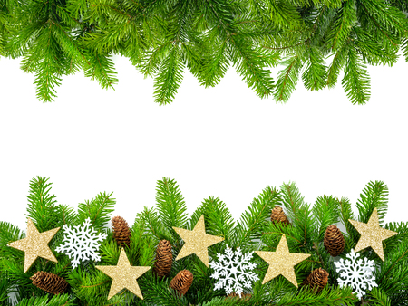 Frame of fresh fir twigs with stars, snow and cones, studio isolated on white background photo