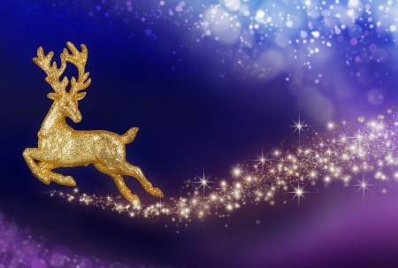 Imaginative Christmas composition with flying golden reindeer in a magical fantasy night sky photo