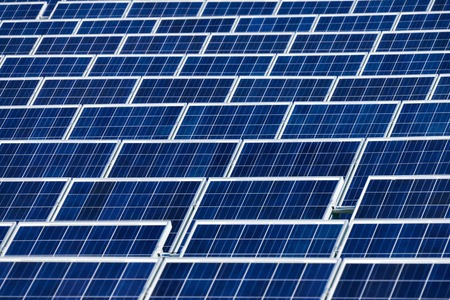 solarpanel: Many rows of large solar panels in a power plant