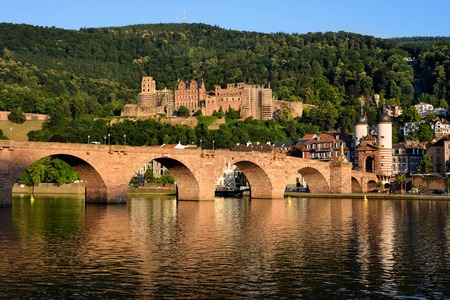 Historic castle and the Old Bridge in Heidelberg, Germany, shot in warm summer evening sunlight photo
