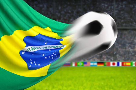 spiffy: Soccer ball in fast motion in front of the Brazilian flag waving in a spiffy way in a football arena Stock Photo