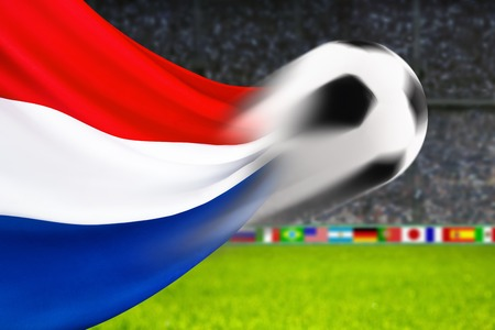 spiffy: Soccer ball in fast motion in front of the Dutch flag waving in a spiffy way in a football arena Stock Photo