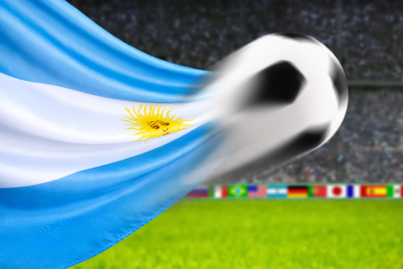 spiffy: Soccer ball in fast motion in front of the Argentinian flag waving in a spiffy way in a football arena