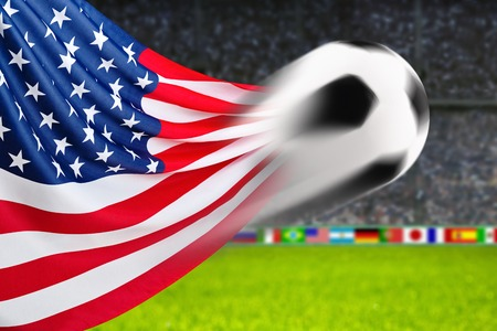 spiffy: Soccer ball in fast motion in front of the American flag waving in a spiffy way in a crowded arena Stock Photo