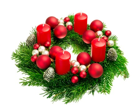 advent advent: Bright studio shot of a nice advent wreath with baubles and four red candles, isolated on white
