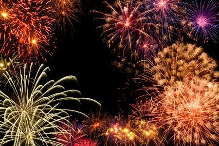 Fantastic multi-colored fireworks display on black night sky