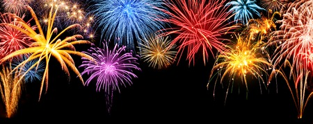 'new year's day': Gorgeous multi-colored fireworks display on black night sky, with freely extendable copyspace Stock Photo