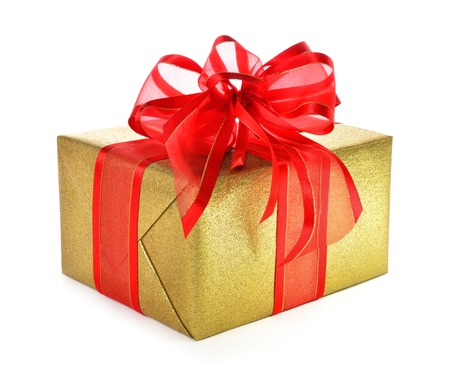gift packs: Gold gift box with red ribbon and a nice fancy bow, studio isolated on white background Stock Photo