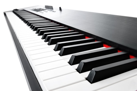 keyboard instrument: Synthesizer keyboard music instrument, studio shot at interesting perspective on white background