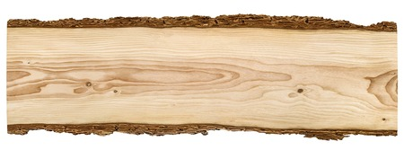 Nice long wooden board framed with beautiful bark isolated on white background