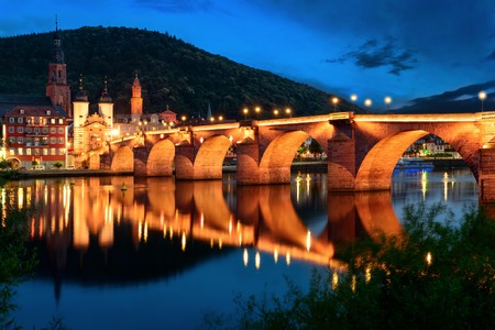 old bridge: Heidelberg, Germany, the Old Bridge at twilight reflected in the water of the Neckar river