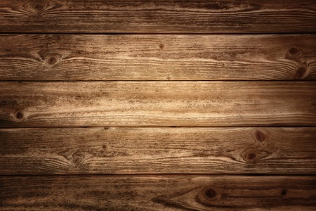 dark wood: Rustic wood planks background with nice studio lighting and elegant vignetting to draw the attention