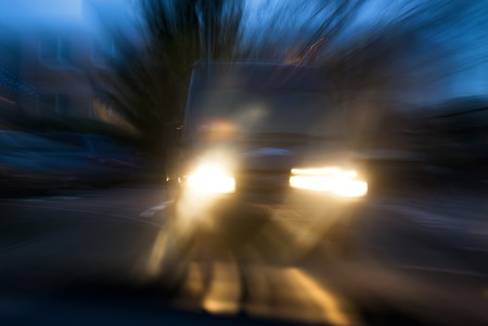 A van approaching in a menacing way in twilight, with deliberate camera shake for the concept of car accident risks