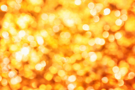 Shining out-of-focus highlights in gold leaves create a bright bokeh composition, ideal as a nature background