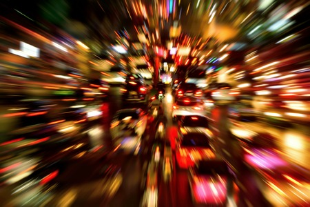 Traffic jam on a large street in the city, night shot with dynamic blur effect 写真素材