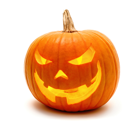 Jack o Lantern Halloween pumpkin grinning in the most evil fashion, isolated on white Foto de archivo
